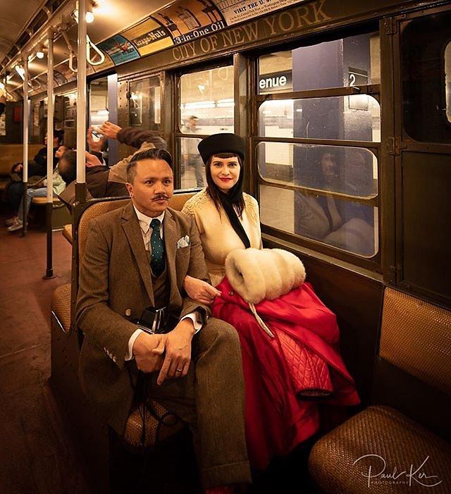 A dapper couple on the nostalgia subway train.